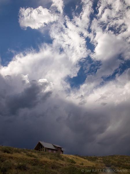 Cabin and approaching storm near Winthrop, Washington
