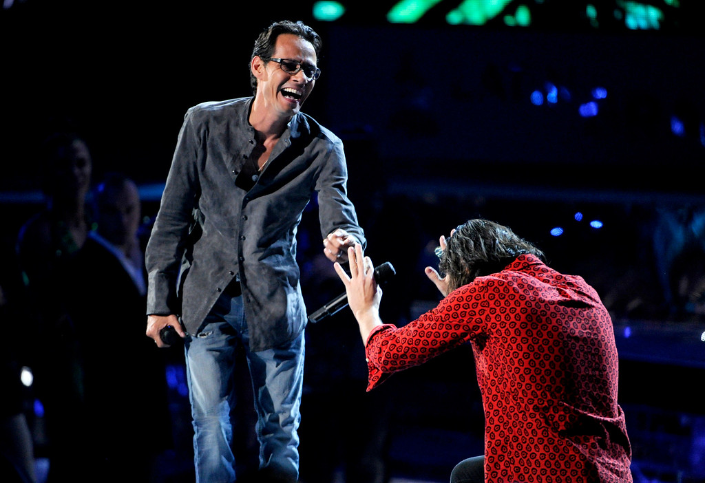 . Marc Anthony, left, and Nasri, of the musical group Magic!, appear at the 15th annual Latin Grammy Awards at the MGM Grand Garden Arena on Thursday, Nov. 20, 2014, in Las Vegas. (Photo by Chris Pizzello/Invision/AP)