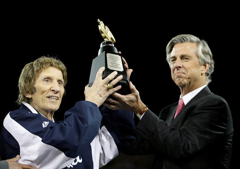 . Detroit Tigers owner Mike Ilitch, left, and general manager Dave Dombrowski, lift the William Harridge Trophy after their team won the American League championship series against the New York Yankees at Game 4, Thursday, Oct. 18, 2012, in Detroit. The Tigers, who won 8-1, move on to the World Series. (AP Photo/Matt Slocum)