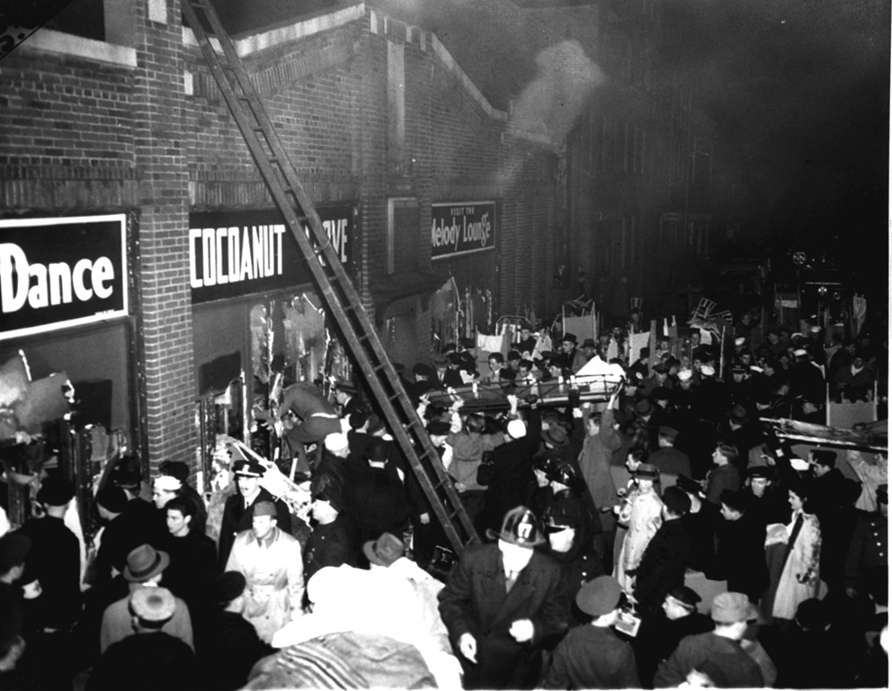 . Boston City fire and police department workers and many servicemen jam the street outside the Cocoanut Grove night club in Boston, Ma., on November 28, 1942, helping to haul out victims of a sudden fire that swept the club before football weekend patrons had a chance to escape.  (AP Photo)