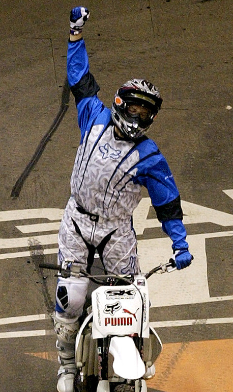 . The 10th X Games at the Staples Center in Los Angeles Thursday August 5,2004. Chuck Carothers of Kingwood, Teaxas win the gold with a score of 93:20 in the Moto X Best Trick. Carothers celebrates after his winning jump.