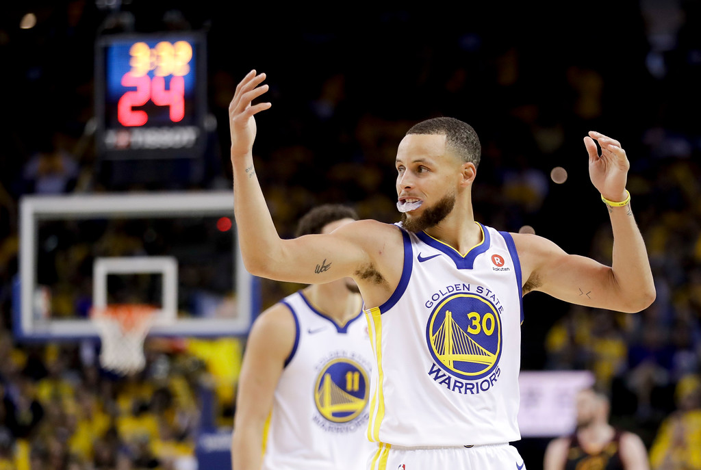 . Golden State Warriors guard Stephen Curry (30) reacts during the second half of Game 1 of basketball\'s NBA Finals against the Cleveland Cavaliers in Oakland, Calif., Thursday, May 31, 2018. (AP Photo/Marcio Jose Sanchez)