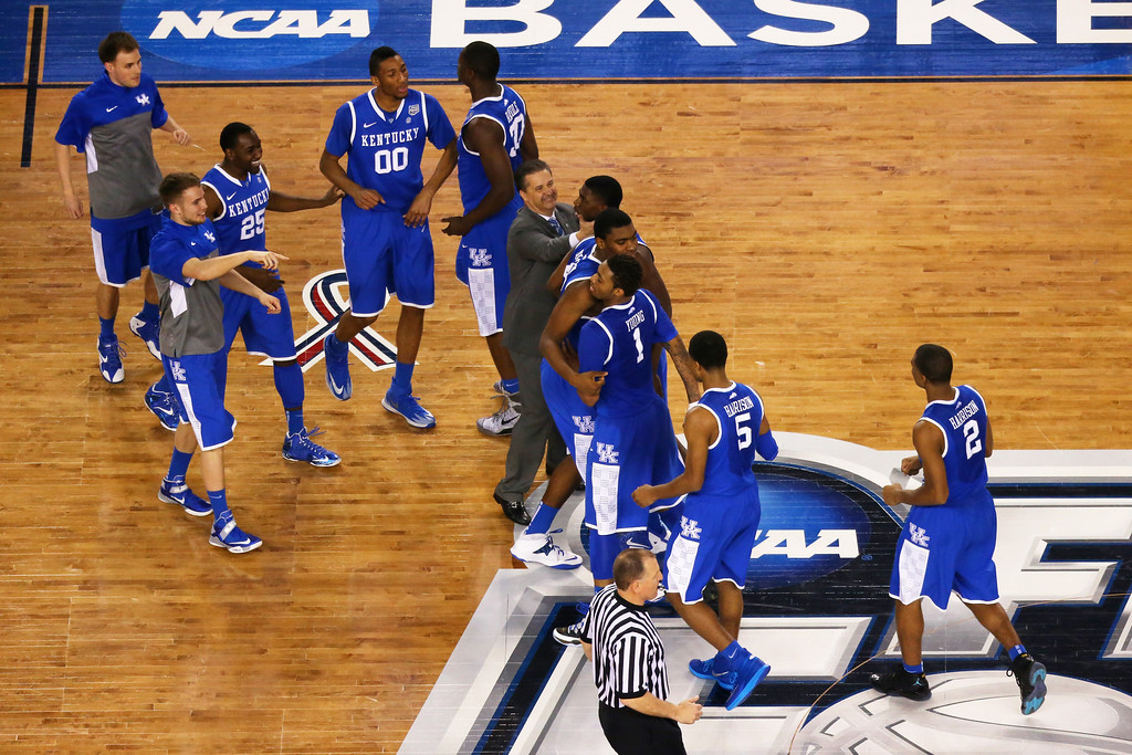 . ARLINGTON, TX - APRIL 05:  The Kentucky Wildcats celebrate after defeating the Wisconsin Badgers 74-73 in the NCAA Men\'s Final Four Semifinal at AT&T Stadium on April 5, 2014 in Arlington, Texas.  (Photo by Ronald Martinez/Getty Images)