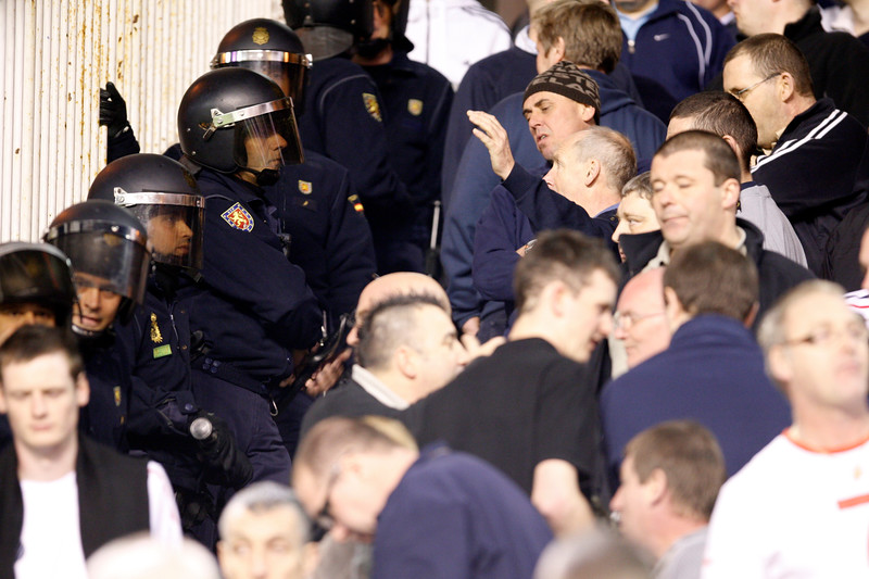 English fans arguing with Spanish riot policemen. Taken during the friendly football game between the national teams of Spain and England that took place in the Sanchez Pizjuan stadium, Seville, Spain, 11 Feb 2009.