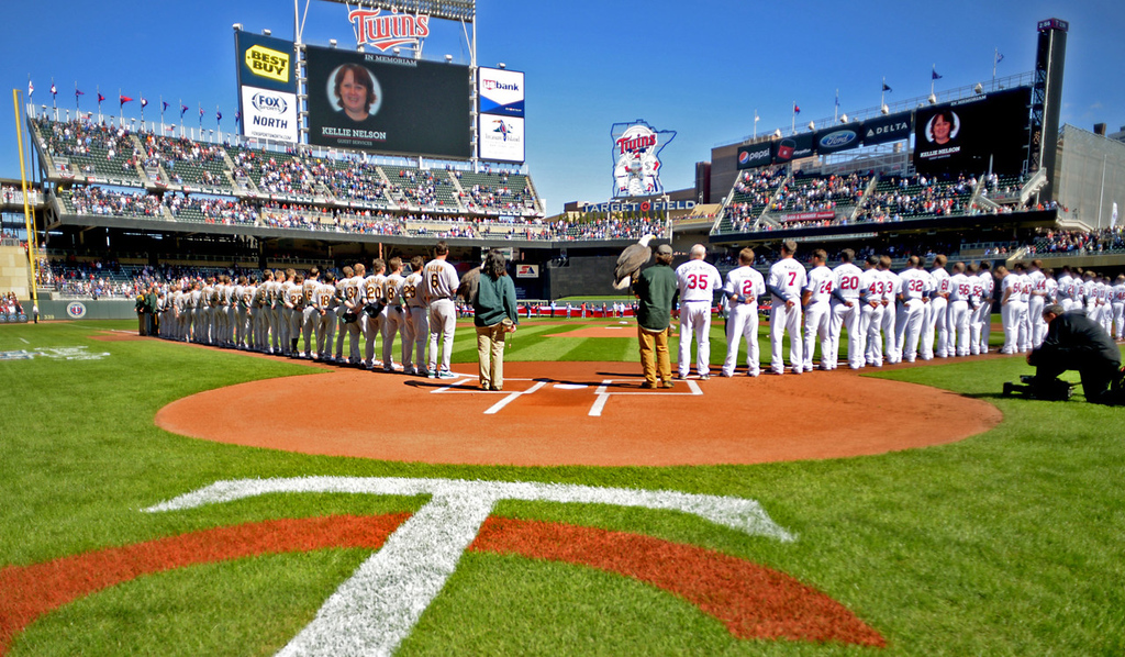 . Minnesota Twins and Oakland A\'s players line up for the National Anthem prior to the start of Monday\'s home opener at Target Field in Minneapolis, April 7, 2014. (Pioneer Press: John Autey)