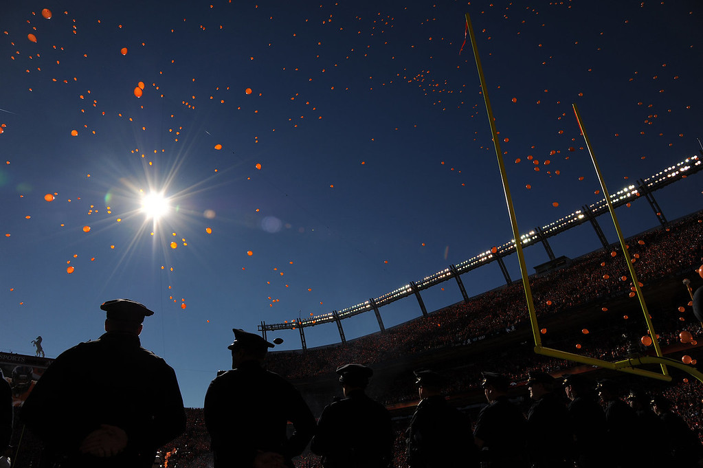 . Law enforcement officers watch as the balloons are released before the start of the game. The Denver Broncos take on the New England Patriots in the AFC Championship game at Sports Authority Field at Mile High in Denver on January 19, 2014. (Photo by Hyoung Chang/The Denver Post)