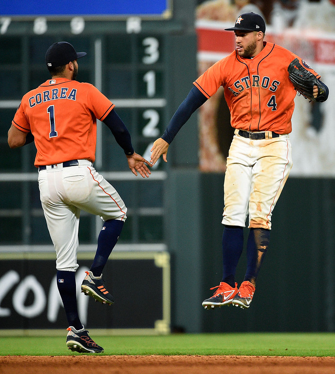 . Houston Astros\' Carlos Correa (1) and George Springer celebrate the team\'s 4-1 win over the Cleveland Indians in a baseball game Friday, May 18, 2018, in Houston. (AP Photo/Eric Christian Smith)