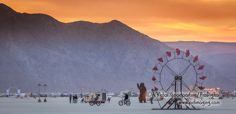 Morning on the playa. In the center, the bear (Ursa Major) is made out of 160,000 pennies. The large ferris wheel is called Parasolvent.