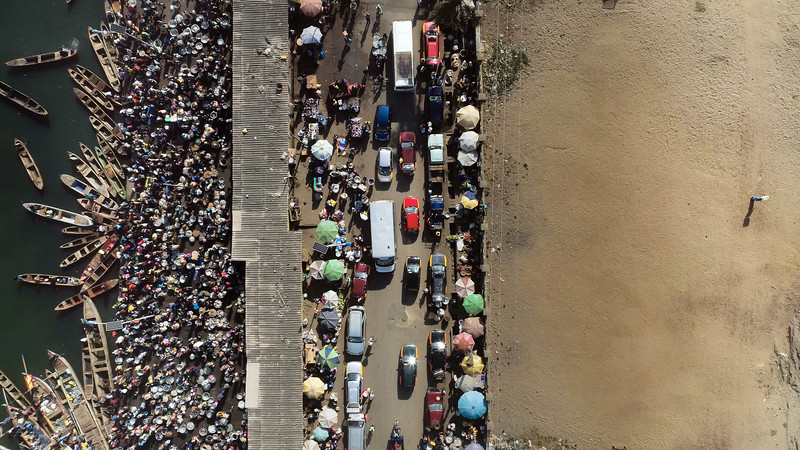 A variety of transportation seen from above in the coastal town Elmina. Elmina translates to inexhaustible supply of water.