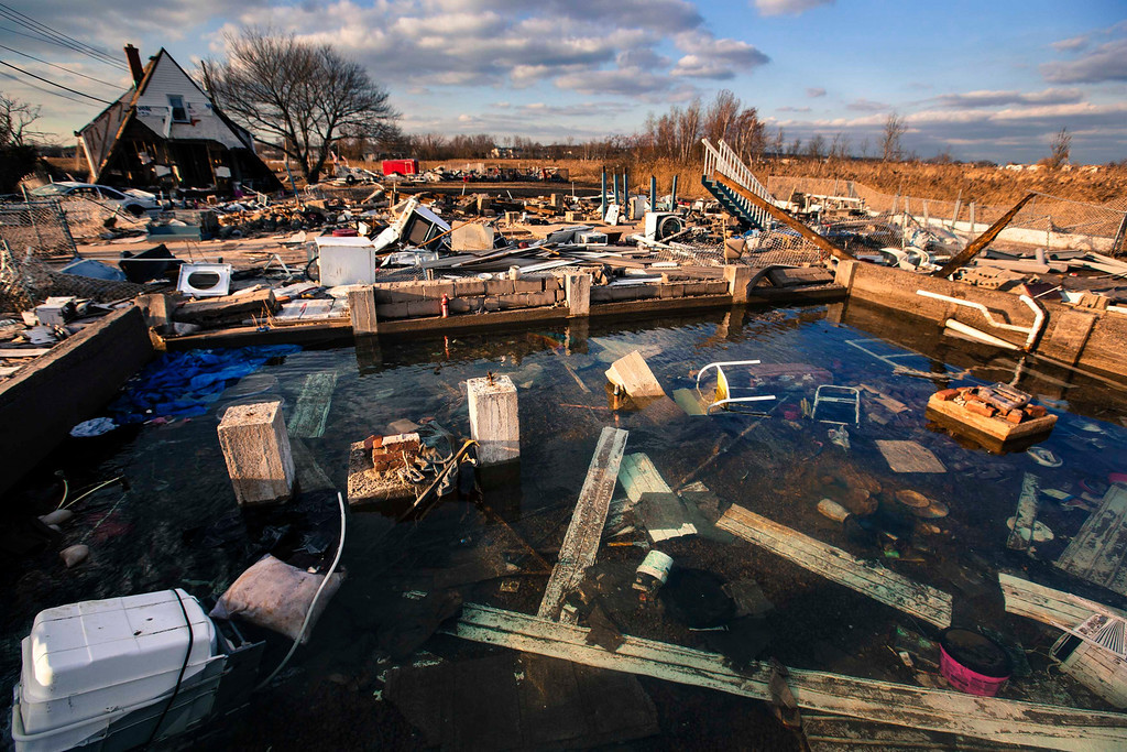 . A still running water pipe floods the foundation of a home destroyed by the storm surge of superstorm Sandy in the Staten Island borough neighborhood of Oakwood in New York, November 28, 2012.  REUTERS/Lucas Jackson