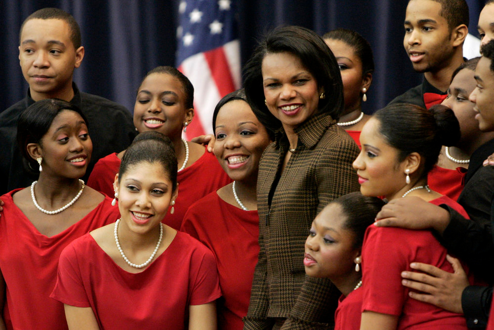 Description of . Secretary of State Condoleezza Rice, center, poses for a photo with members of the Duke Ellington School of the Arts Show Choir following their performance at the State Department in Washington, Friday, Feb. 22, 2008, during an event celebrating Black History Month 2008. (AP Photos/Susan Walsh)