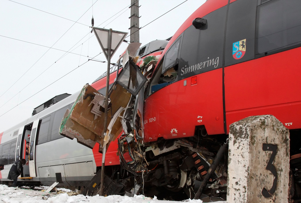 Description of . Two demolished S45 trains are pictured after a train crash in Vienna January 21, 2013. Two trains collided Monday morning, injuring 25 people, police said. REUTERS/Heinz-Peter Bader (AUSTRIA - Tags: DISASTER TRANSPORT)