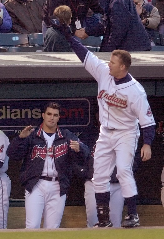 . Cleveland Indians\' Jim Thome makes a curtain call after hitting a grand slam off of Minnesota Twins pitcher Rick Reed in the second inning Wednesday, April 10, 2002, in Cleveland. Thome\'s slam contributed to a six-run inning to help Indians pitcher Danys Baez, left. (AP Photo/Mark Duncan)