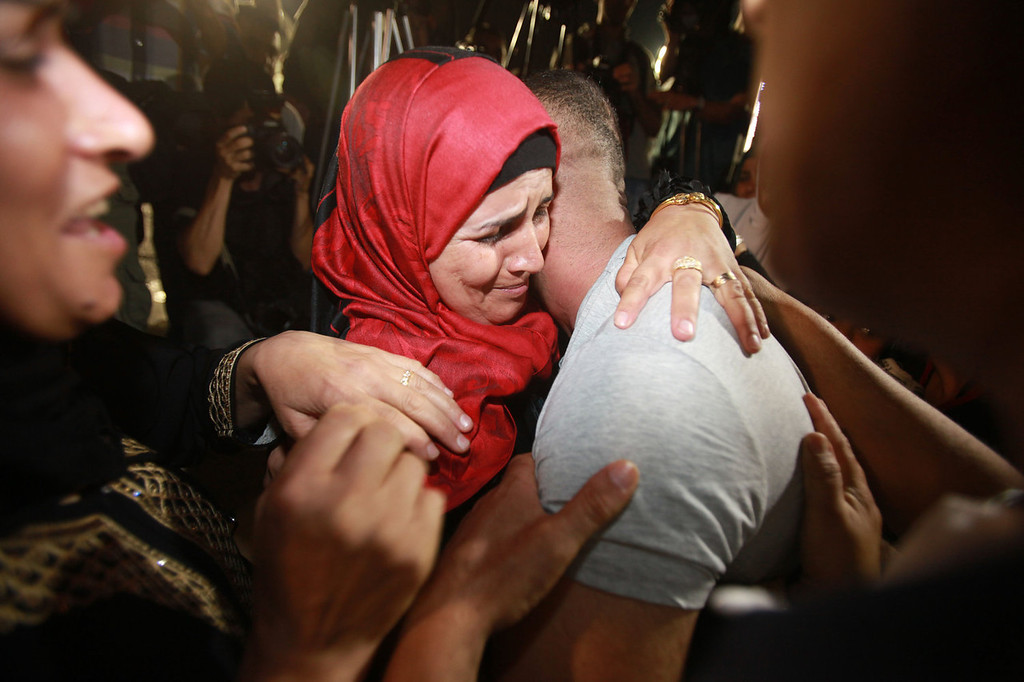 . Palestinian prisoners freed from Israeli detention are greeted in the city of Ramallah on August 14, 2013. The release of the prisoners, all but one of whom were jailed before the Palestinian Authority was formed in 1994, has been hailed by Palestinian negotiators but has incensed some Israeli officials.   ABBAS MOMANI/AFP/Getty Images