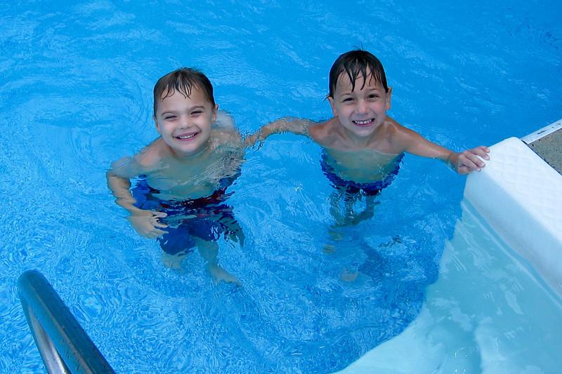 K.C. swimming with Amleto at Amleto's mom-mom's pool.