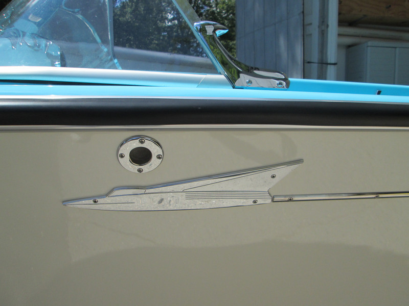 Port side with new fuel vent and rechromed ornament.
