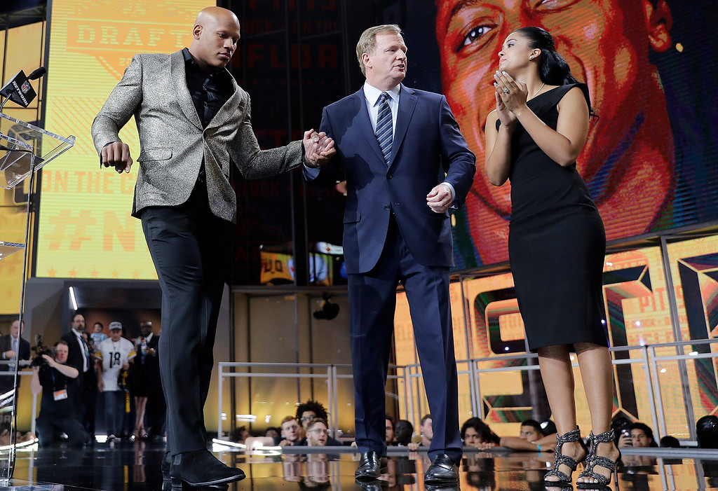 . Ryan Shazier, left, and his wife Michelle, right, stand with commissioner Roger Goodell, during the Pittsburgh Steelers\' selection in the first round of the NFL football draft, Thursday, April 26, 2018, in Arlington, Texas. (AP Photo/David J. Phillip)