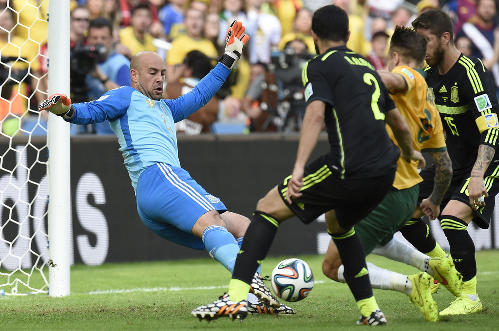 . Australia\'s forward Adam Taggart (2nd R) takes a shot at goal during a Group B match between Australia and Spain at the Baixada Arena in Curitiba during the 2014 FIFA World Cup on June 23, 2014.   AFP PHOTO / JUAN  BARRETO/AFP/Getty Images
