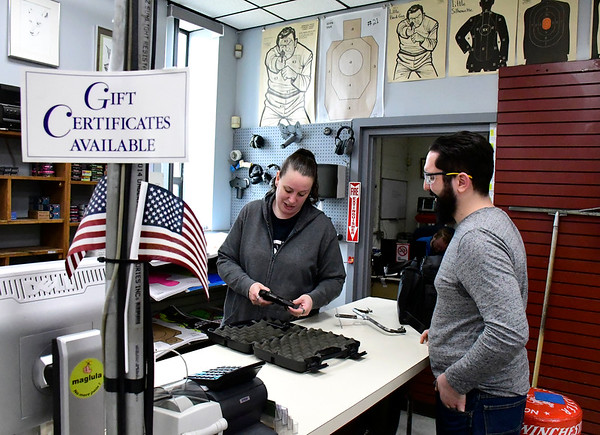 3/20/2020 Mike Orazzi | Staff Tammy Cyr talks with Raymond Marquis after he purchased a gun at Wolf's Indoor Range and Shooting Center in Bristol on Friday. Even though Marquis has a valid pistol permit, the process was delayed by the an overload at Connecticut Department of Emergency Services and Public Protection because of high demand.