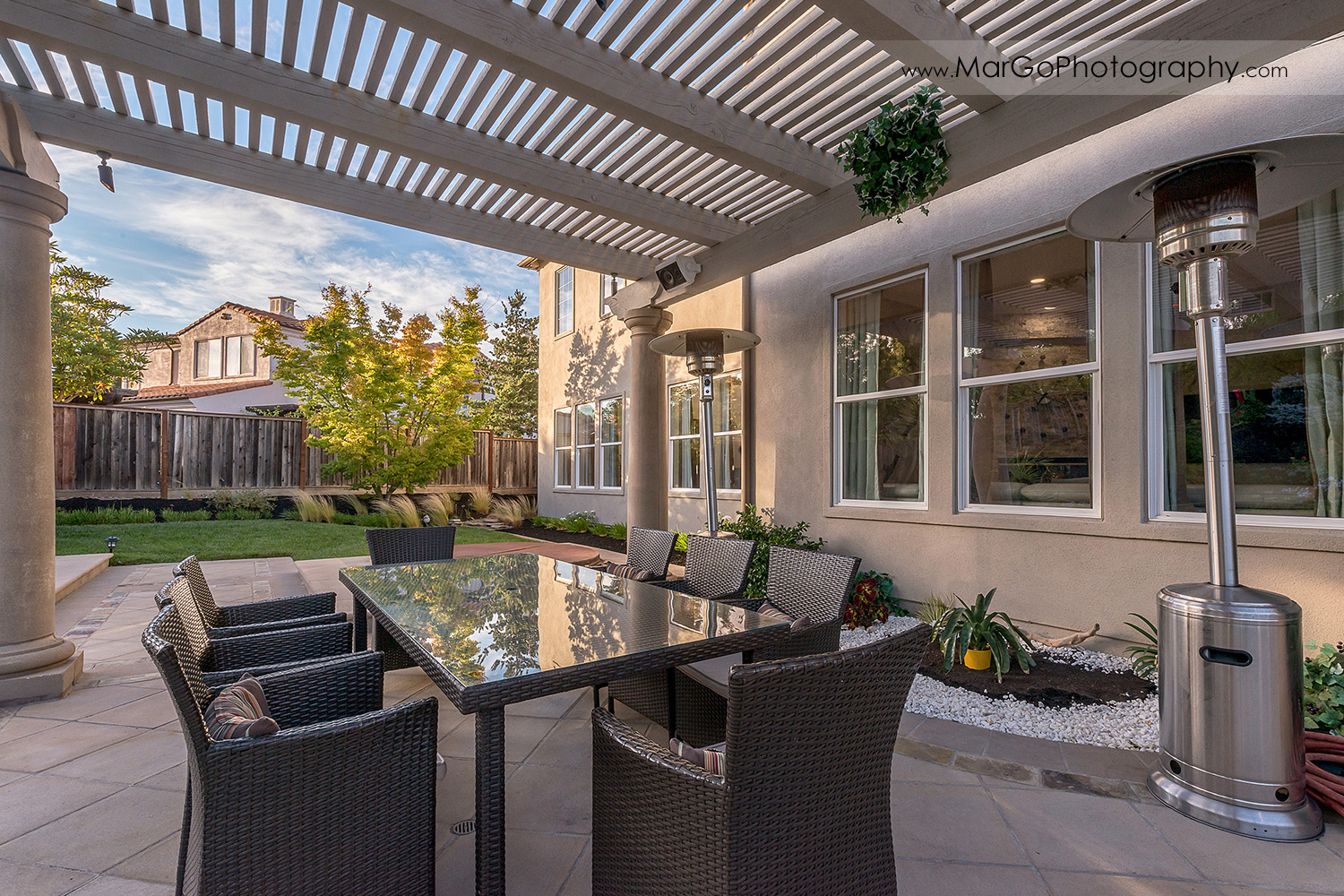 backyard patio with white pergola behind San Ramon house - real estate photography