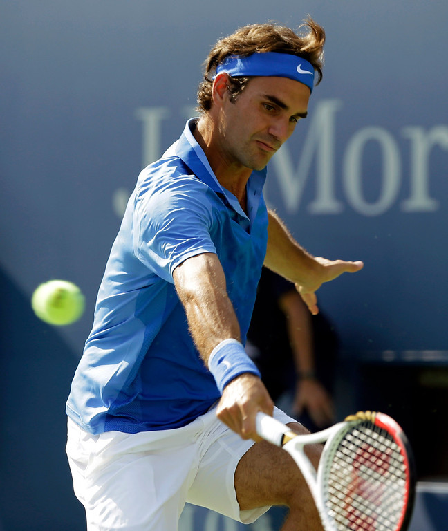 . Roger Federer, of Switzerland, returns a shot to Grega Zemlja, of Slovenia, during the first round of the 2013 U.S. Open tennis tournament Tuesday, Aug. 27, 2013, in New York. (AP Photo/Mike Groll)