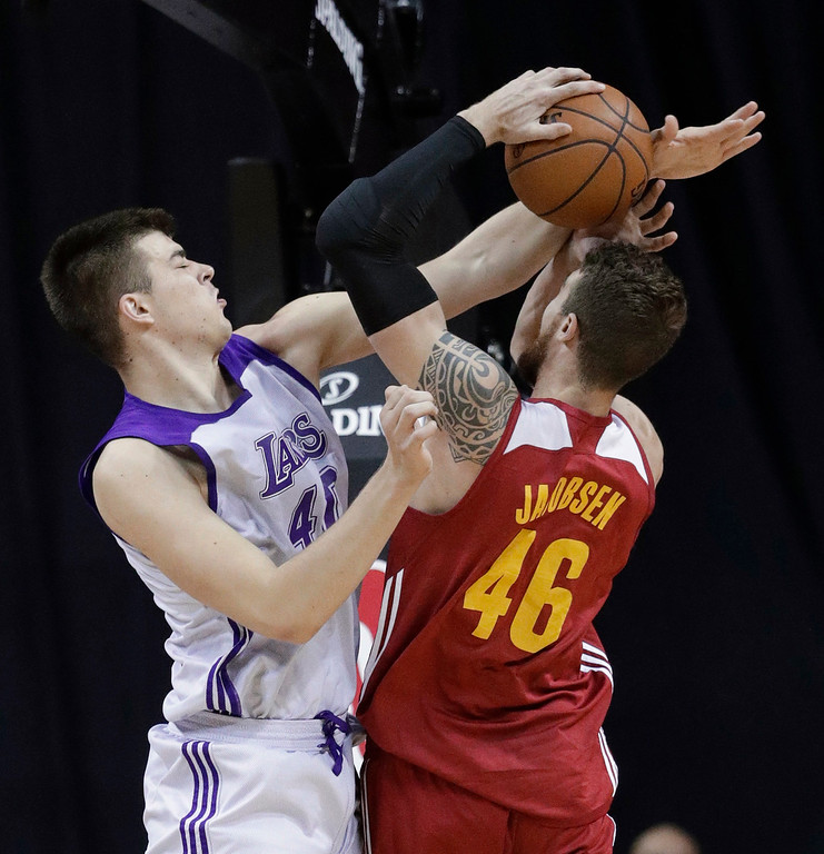 . Los Angeles Lakers\' Ivica Zubac fouls Cleveland Cavaliers\' Eric Jacobsen during the first half of an NBA summer league basketball game Thursday, July 14, 2016, in Las Vegas. (AP Photo/John Locher)