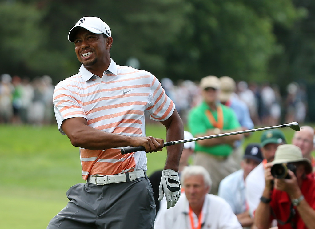 . Tiger Woods of the United States grimaces after hitting his second shot on the eighth hole during Round Two of the 113th U.S. Open at Merion Golf Club on June 14, 2013 in Ardmore, Pennsylvania.  (Photo by Andrew Redington/Getty Images)