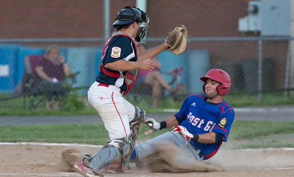 06/27/19 Wesley Bunnell | Staff Berlin Post 68 Legion baseball vs Southington Post 72 on Thursday June 27, 2019. Southington's catcher Josh Panarella (7) on a close play at the plate.
