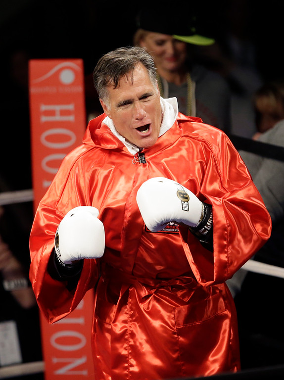 . Former Republican presidential candidate Mitt Romney walks in to the ring before sparring with five-time heavyweight boxing champion Evander Holyfield at a charity fight night event Friday, May 15, 2015, in Salt Lake City. The black-tie event will raise money for the Utah-based organization CharityVision, which helps doctors in developing countries perform surgeries to restore vision in people with curable blindness. (AP Photo/Rick Bowmer)
