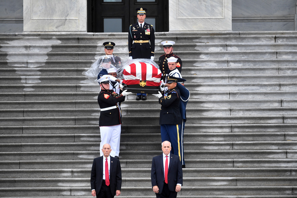 . The casket of Sen. John McCain, R-Ariz., is carried down the steps of the U.S. Capitol in Washington, Saturday, Sept. 1, 2018, in Washington, for a departure to the Washington National Cathedral for a memorial service. (Marvin Joseph/The Washington Post via AP, Pool)