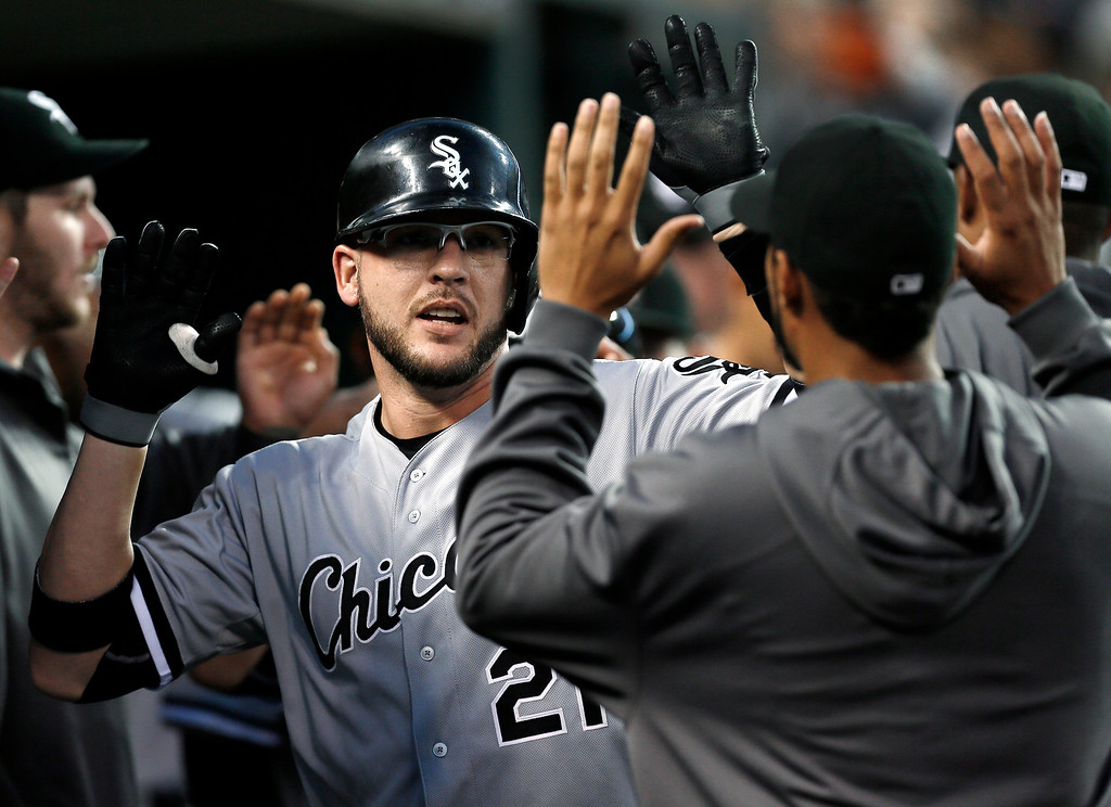 . Chicago White Sox\'s Tyler Flowers celebrates his two-run home run against the Detroit Tigers in the second inning of a baseball game in Detroit Monday, Sept. 22, 2014. (AP Photo/Paul Sancya)