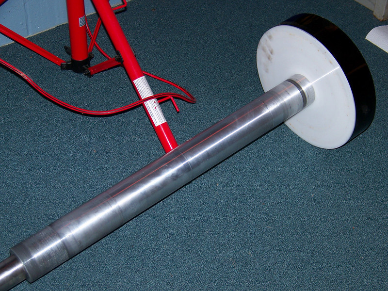 The declination shaft. interesting to note some items here. First the shaft comes together in two parts. First is the larger portion where the bearings fit. This is made of aluminum. The other part consists of a smaller shaft made of stainless steel that screws into the larger shaft. The stainless steel portion is the one that attaches to the counterweight system and everyone can see from the outside. The aluminum shaft appears to be of sloppy tolerance and bearing fit. There is a thin teflon disk which can be seen in this image which is against the large aluminum disk. This telfon disk also acts as a clutch. It has been determined by myself and confirmed by others that the shaft is 3 to 4 thousandths out of round at the bearing. This is unacceptable for astronomical purposes!! The telescope will bind in some spots and become too loose in others, depending on the moment arm of the telescope tube. Additionally the issue was resolved by Parrallax. This is a obvious problem  with Joe Nastasi's machine work.