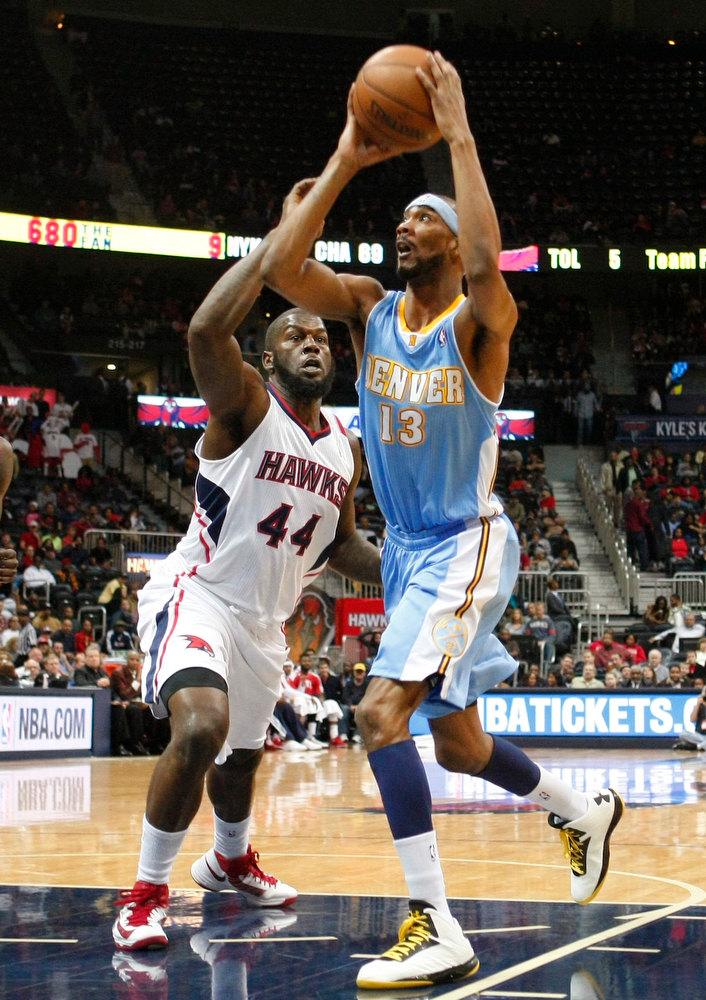 . Atlanta Hawks forward Ivan Johnson (44) defends against Denver Nuggets forward Corey Brewer in the first half of their NBA basketball game in Atlanta, Georgia December 5, 2012.   REUTERS/Tami Chappell