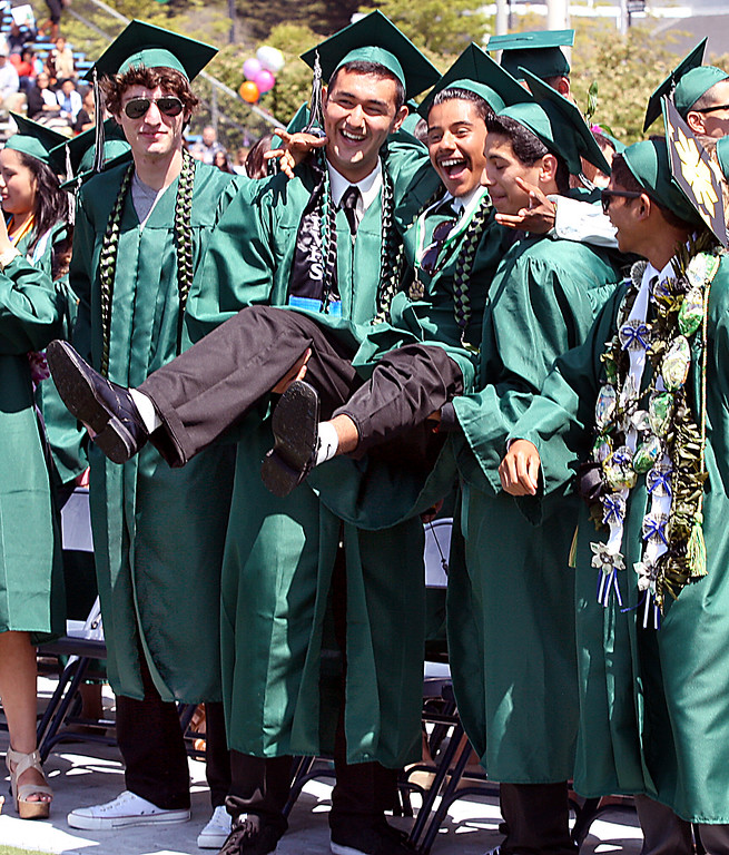. Pajaro Valley High grads ham it up in the front row of their graduation ceremony Thursday at Cabrillo College.  (Dan Coyro/Sentinel)