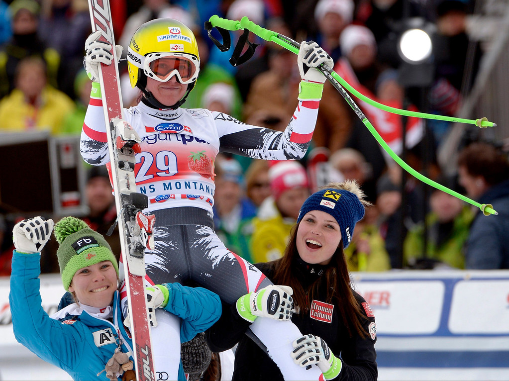 . Andrea Fischbacher (up) of Austria celebrates in the finish area with Austria\'s Nicole Schmidhofer (L) and Anna Fenninger (R) during the Women\'s Downhill race of the FIS Alpine Skiing World Cup  in Crans-Montana, Switzerland on March 2, 2014.  EPA/ALESSANDRO DELLA VALLE