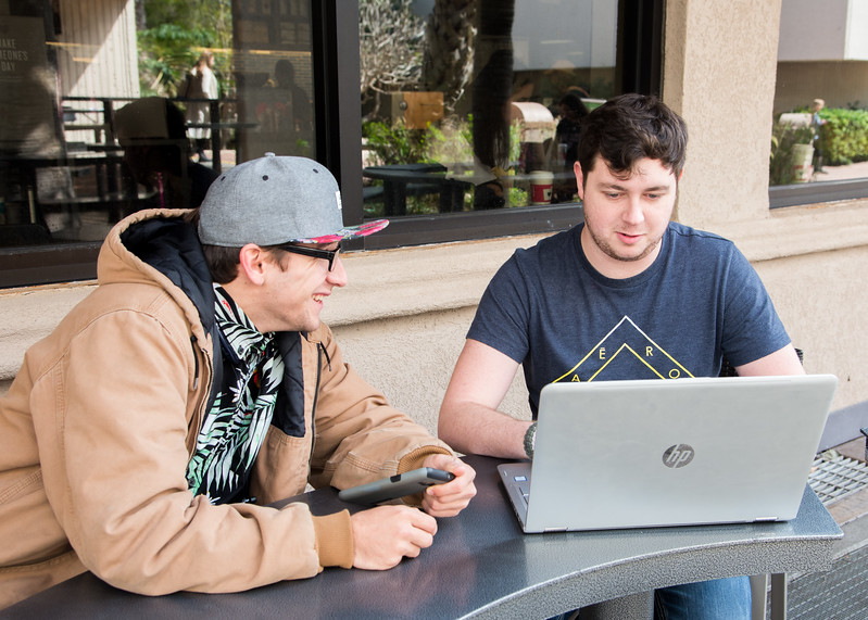 Students Colton Saenz (Left) ((QC)) and Clay Rogers work on a communication presentation.