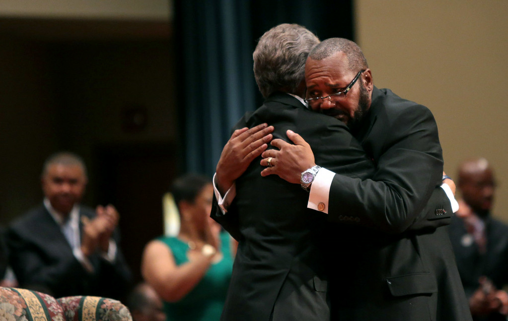 . Pastor Charles Ewing, the uncle of Michael Brown, embraces Rev. Al Sharpton (L) after delivering a eulogy during the funeral of Michael Brown inside Friendly Temple Missionary Baptist Church on August 25, 2014 in St. Louis Missouri. Michael Brown, an 18 year-old unarmed teenager, was shot and killed by Ferguson Police Officer Darren Wilson in the nearby town of Ferguson, Missouri on August 9. His death caused several days of violent protests along with rioting and looting in Ferguson.  (Photo by Robert Cohen-Pool/Getty Images)