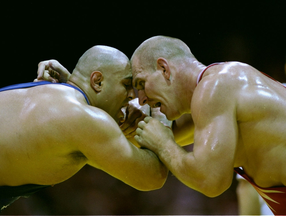 Description of . 23 Jul 1996: Siamak Ghaffari of the USA, right, in action against Aleksandr Karelin of Russia in their Greco-Roman bout at the Georgia World Congress Centre at the 1996 Centennial Olympic Centre in Atlanta, Georgia. The greatest Greco-Roman wrestler in Olympic history, Karelin was undefeated for 13 years.