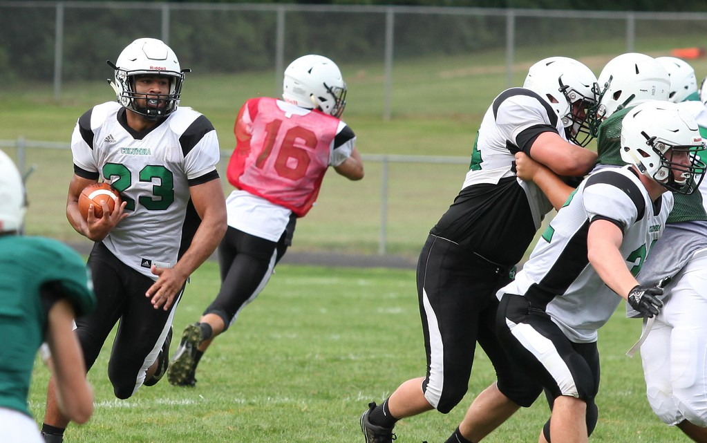 . Randy Meyers - The Morning Journal Columbia running back Brandon Coleman runs behind his blockers against Elyria Catholic during a scrimmage.