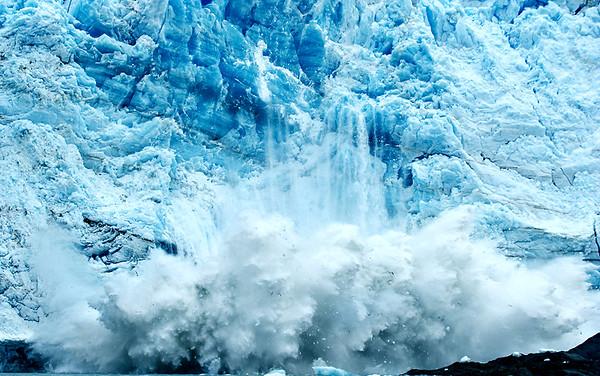 Hubbar Gacier calving chunks of ice into Russell Fjord, Wrangell St. Elias National Park, Alaska.