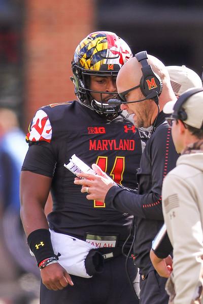 Maryland Interim Head Coach Matt Canada speaks with Maryland QB #11 Kasim Hill