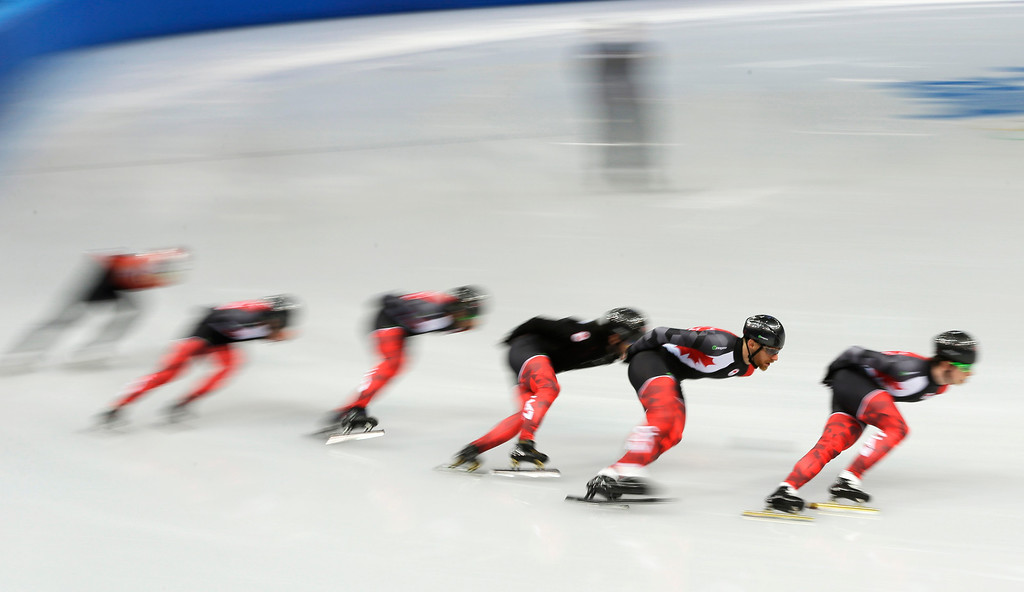 . Members of the Canadian short track speed skating team practice during a training session at the Iceberg Skating Palace ahead of the 2014 Winter Olympics, Tuesday, Feb. 4, 2014, in Sochi, Russia. (AP Photo/Mark Baker)