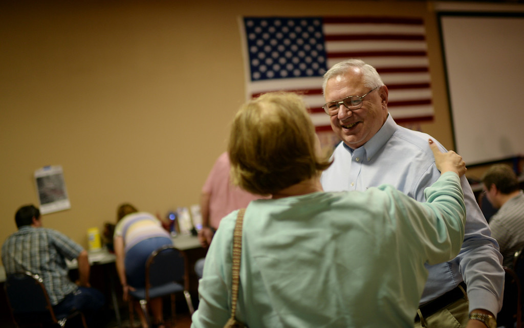 . COLORADO SPRINGS, CO - September 10 : Bernie Herpin, Republican nominee, right, in Colorado El Paso County Republican Party Headquarters with his campaign staff and volunteers during the recall election. Colorado Springs, Colorado. September 10, 2013. (Photo by Hyoung Chang/The Denver Post)