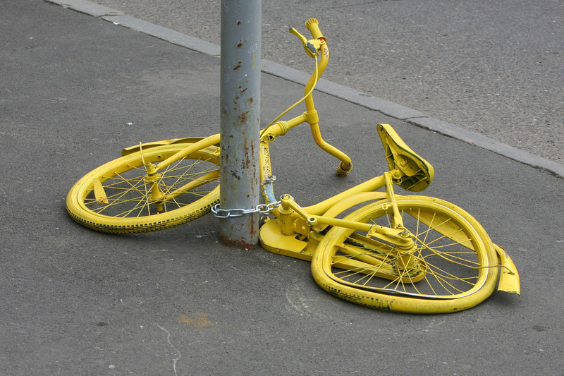 I saw several abandoned bikes painted yellow. Not sure why. Is it recycled art?