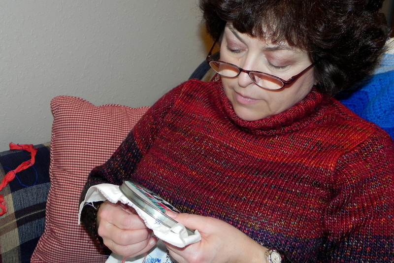2012-1-8 ––– There is a story behind the picture. Lisa is working on cross stitch for a Christmas stocking. It is for our daughter-in-law, Kristen. Lisa started this stocking just after they were married in 2005. It is now 2012 and she is determined to finish it before Christmas of 2012. I'll have to revisit this story at the end of the year to report back on if she finished it. After six years it should be truly amazing.