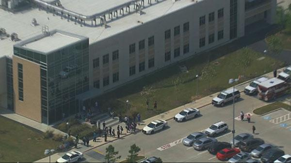 Description of . This frame grab provided by KTRK shows the scene above the Cy-Fair campus of Lone Star Community College in Cypress, Texas, where officials say about a dozen people have been wounded in a stabbing attack Tuesday, April 9, 2013. (AP Photo/KTRK)