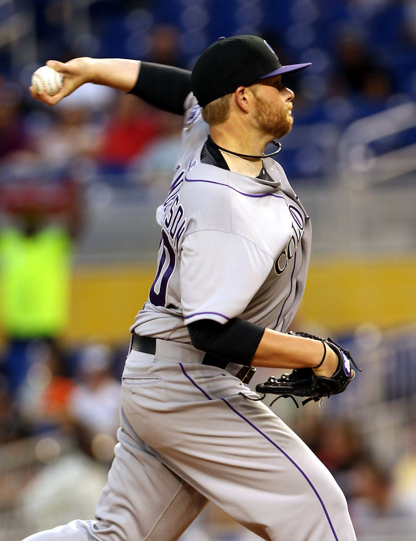 . Pitcher Brett Anderson #30 of the Colorado Rockies  throws against the Miami Marlins during the second inning at the Marlins Park on April 1, 2014 in Miami, Florida.  (Photo by Marc Serota/Getty Images)