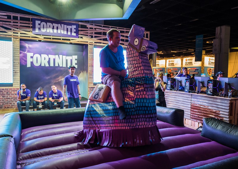 Riding the llama at Fortnite booth