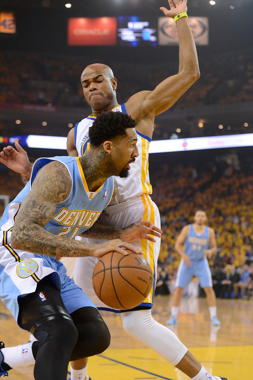 . OAKLAND, CA. - APRIL 26: Wilson Chandler (21) of the Denver Nuggets drives on Jarrett Jack (2) of the Golden State Warriors during the first quarter in game 3 of the first round of the NBA Playoffs April 26, 2013 at Oracle Arena.  (Photo By John Leyba/The Denver Post)