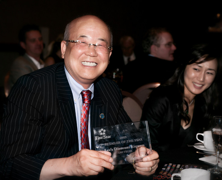 Father - - Mister Lee, owner of Lee's Discount Liquors receives Retailer Award of The Year from 5-Star